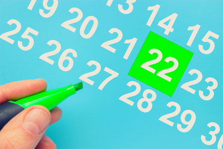 Earth day marked on the calendar on blue background Stock Photo