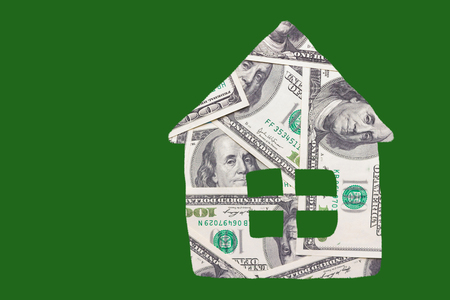 house made from money on green background