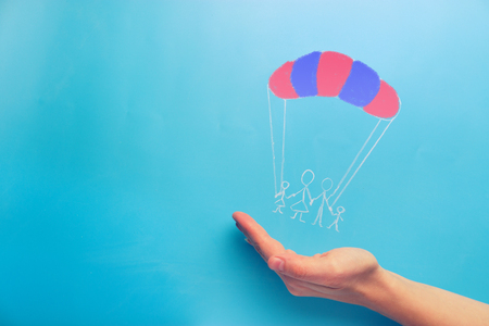 Social protection concept. family on the parachute