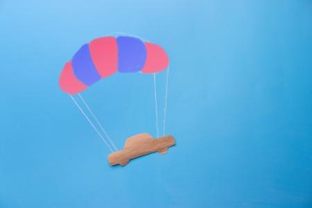 car on parachute. car insurance security concept