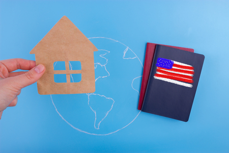 american citizen passport on world map with flag Stock Photo