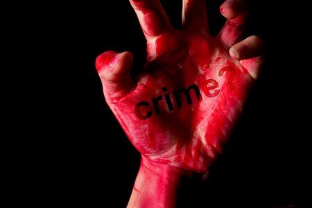 hand in blood on black background. crime comcept