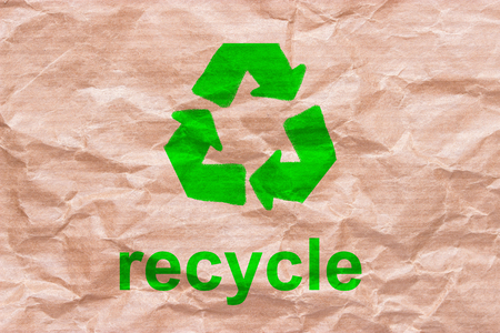 recycle sign on wrapping paper. reuse reduce recycle concept Stock Photo