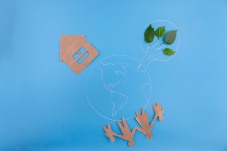 Environmental green energy concept. house and family on the earth planet Stock Photo