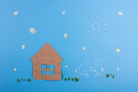 paper house cow and milk drops. milk farm concept