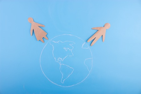 international love concept. paper couple stand on the earth