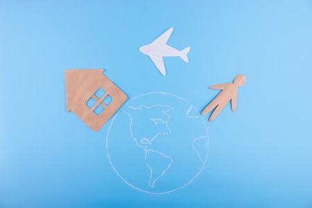 fly home concept. paper percon plane amd house Stock Photo