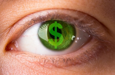 Closeup image of a woman with a dollar symbol in his eye