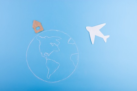 paper plane fly above the earth planet