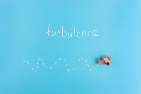paper plane on blue background. turbulence concept