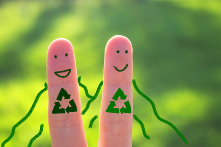 Superhero of recycle concept. two fingers on green background Stock Photo