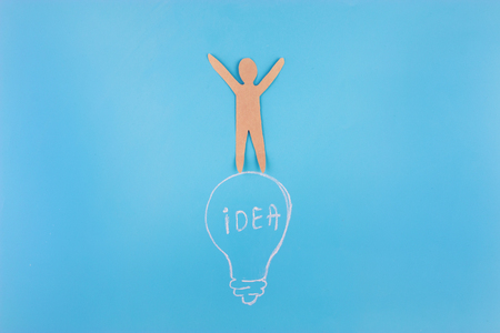 Business Idea concept. paper man stand on lightbulb