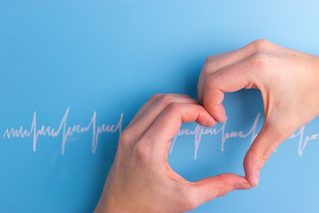 heart and cardiogram on the blue background