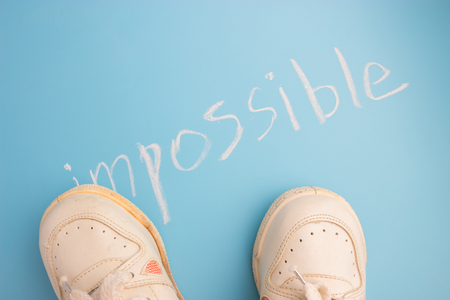 winning and possibilities concept. sneackers on blue background Archivio Fotografico
