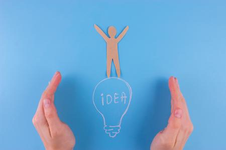 Business Idea concept. paper man stand on lightbulb