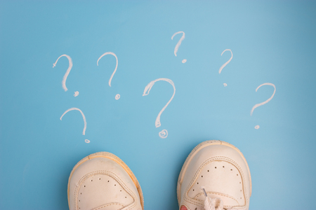 sneaker on blue background Surrounded by question marks