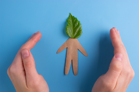 Think green concept. paper person with green leaf on the head Stock Photo