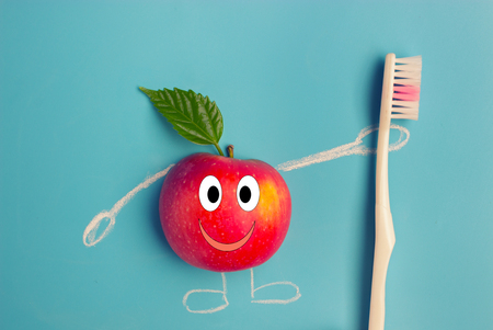 apple character holding a toothbrush on blue background