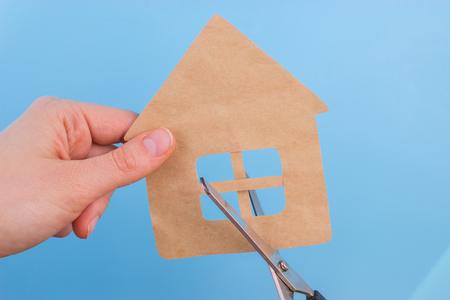 property division concept. scissors cut paper house Standard-Bild - 105035816