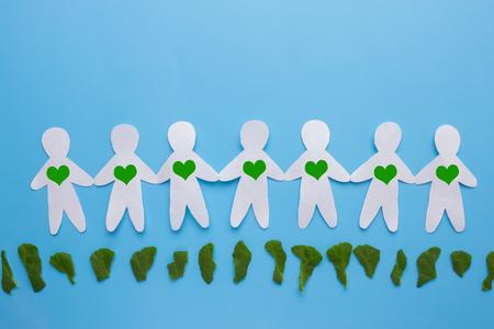 paper people with green hearths. environment concept Stock Photo