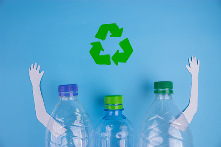 character plastic bottle with poster. recycle concept