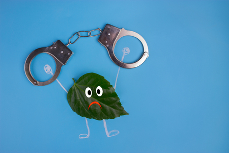 green leaf character in the handcuff. save nature concept
