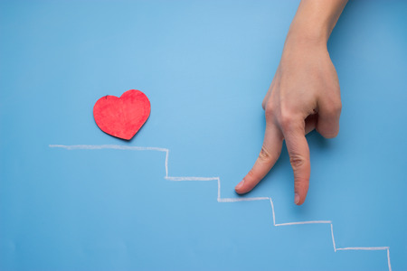 heart on the stairs. hand go up the stairs