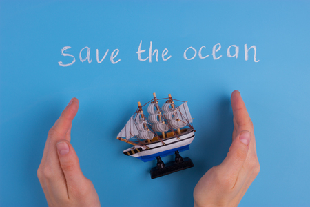 save the ocean concept on blue background