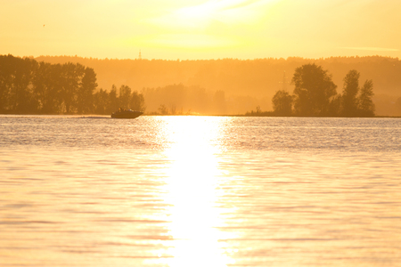 small boat in the river in sunset light