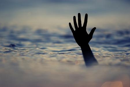 Drowning victims, Hand of drowning man needing help.