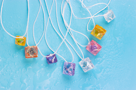 colorful glass pendants on light background. Stock Photo