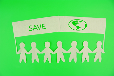ecology concept. paper people holding banners