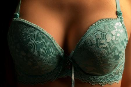 beautiful female in a blue bra