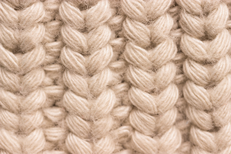 Close-up of knitted wool sweater. grey colour