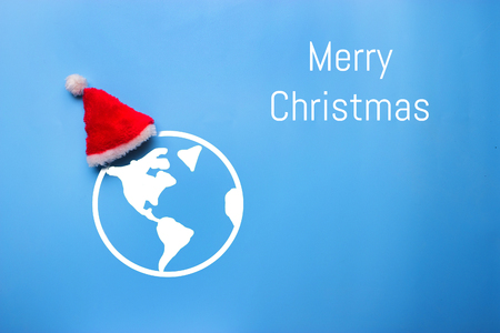 santa claus hat on the earth. christmas and new year concept