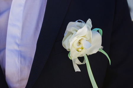 Groom with blue suit and white tie close up Stock Photo
