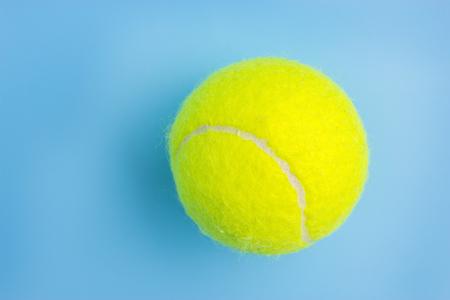 Big tennis ball on blue background - Trendy minimal design top view 写真素材