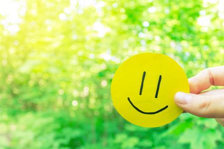 happy smile face made from paper in the nature Stock Photo