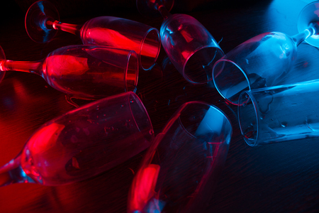 many glasses in neon light. party concept