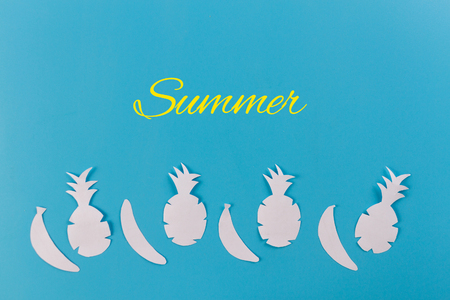 summer concept image. pineapples on blue background Stock Photo