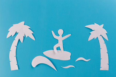 surf concept image, surfboards and palm trees. paper cut