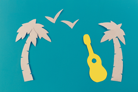 guitar on the beach In the summer. paper cut Archivio Fotografico