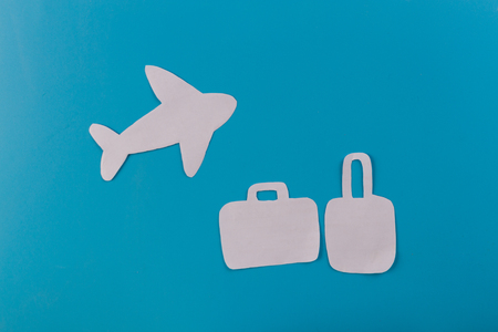 Suitcase at the beach. airplane. paper cut