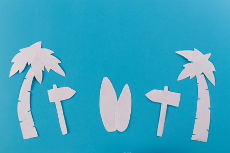 TIps of surf board on the beach. paper cut