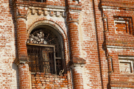 old ruined building. red bricks. window with lattice 스톡 콘텐츠