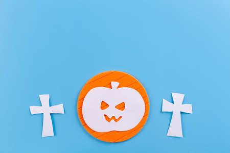 halloween concept image. . graveyard made from paper. blue background