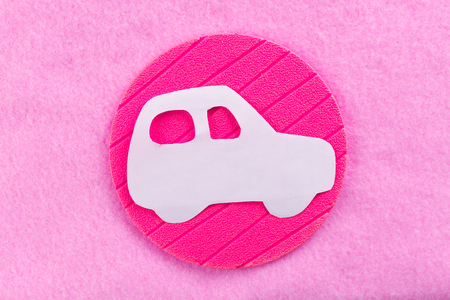 woman car concept image. paper car on pink background