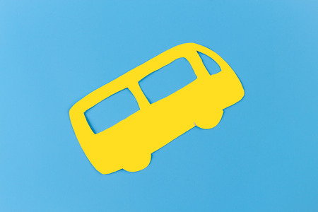 school bus on blue background. paper cut