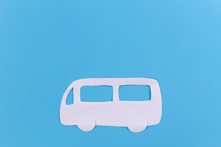 school bus on blue background. paper cut