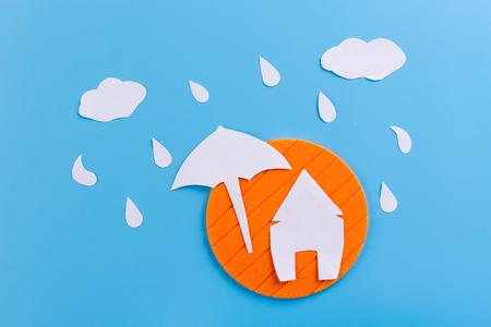 house under an umbrella made of paper